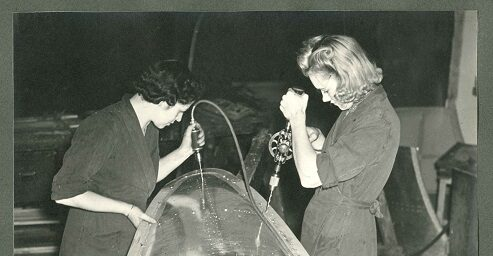 Two female engineers work on an aircraft